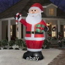 12 Ft GIANT SANTA CLAUS HOLDING CANDY CANE Christmas Lighted Yard Inflatable