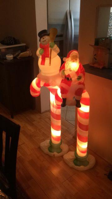 Santas Best Snowman And Santa Candy Cane Blow Mold